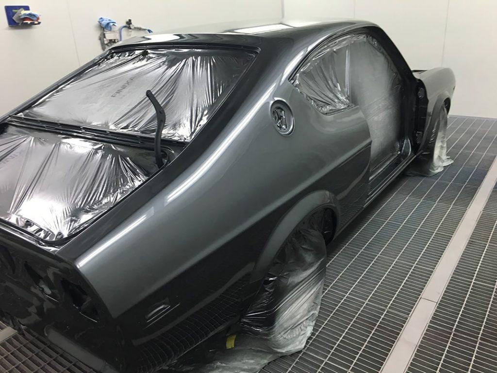 Spray painting coat black